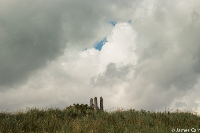 Three stakes and a hole in the clouds. Termonfeckin Beach, Co. Louth